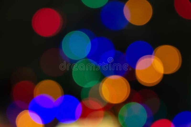 Lumières colorées de bokeh Fond abstrait de Noël photographie stock