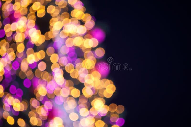 Lumières de Bokeh de l'arbre d'an neuf image libre de droits