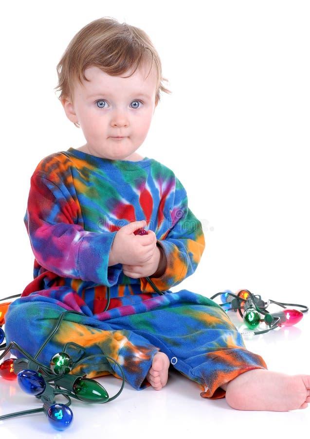 Lumières de fixation d'enfant en bas âge image stock