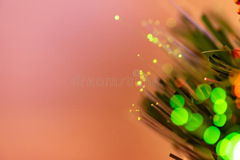 Lumières de Noël avec le fond unfocused de couleur photo stock