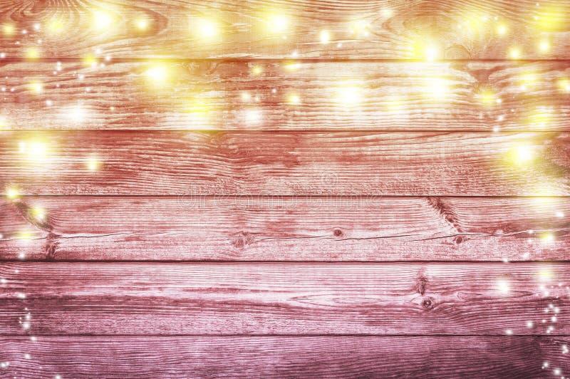 Lumières de Noël sur un vieux fond en bois Backgrou de Noël photographie stock libre de droits