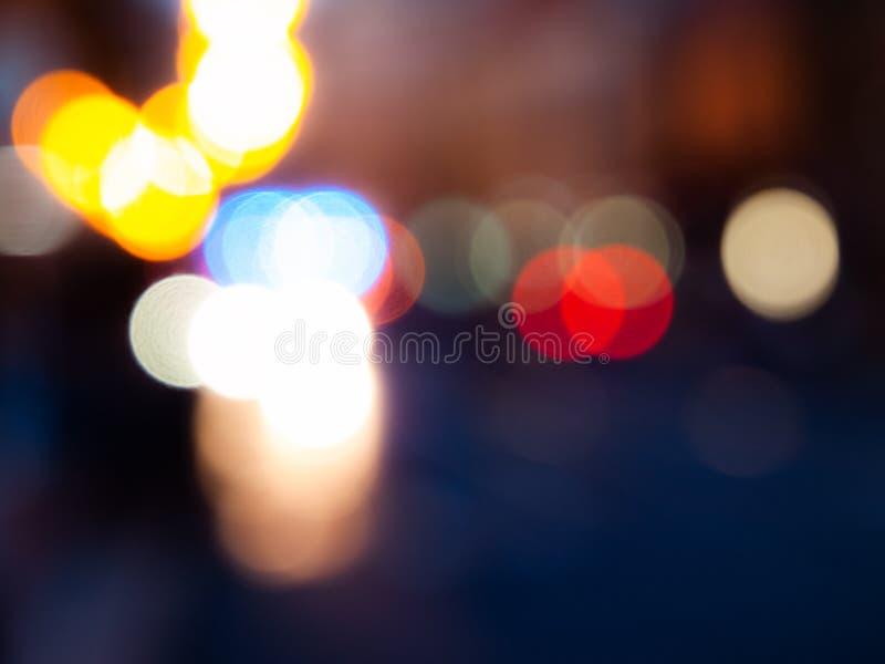 Lumières de ville du trafic de nuit Image unfocused abstraite avec le bokeh photos stock