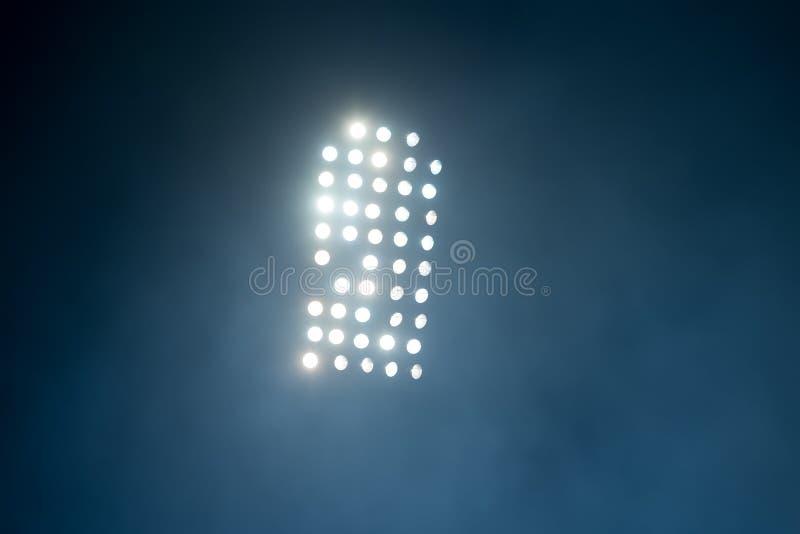 Lumières et fumée de stade photo stock