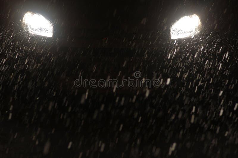 Lumières principales de chutes de neige photo libre de droits