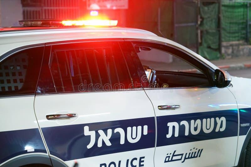 Lumières rouges sur la voiture de police israélienne photographie stock libre de droits