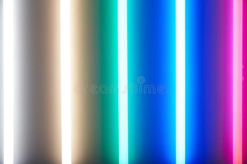 Luminescent lamps with various color of a luminescence. Energy Saving Technologies. Background stock photo