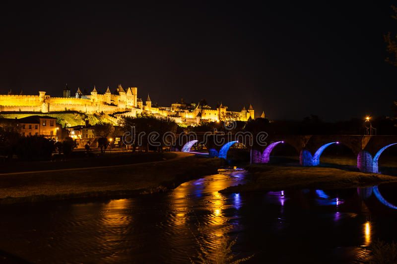 Luminous bridge arches and medieval ramparts. Of ancient walled city of Carcassonne. Carcassonne is a UNESCO World Heritage Site medieval walled city dating royalty free stock images