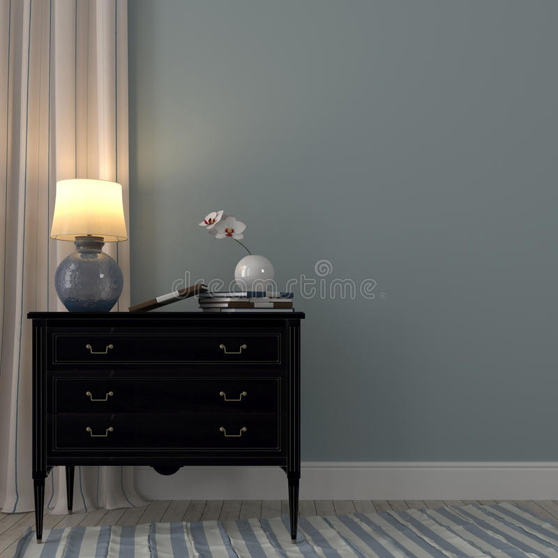 Luminous lamp on the black dresser. The classic black dresser and the luminous lamp on a background of blue wall and striped curtain royalty free stock photo