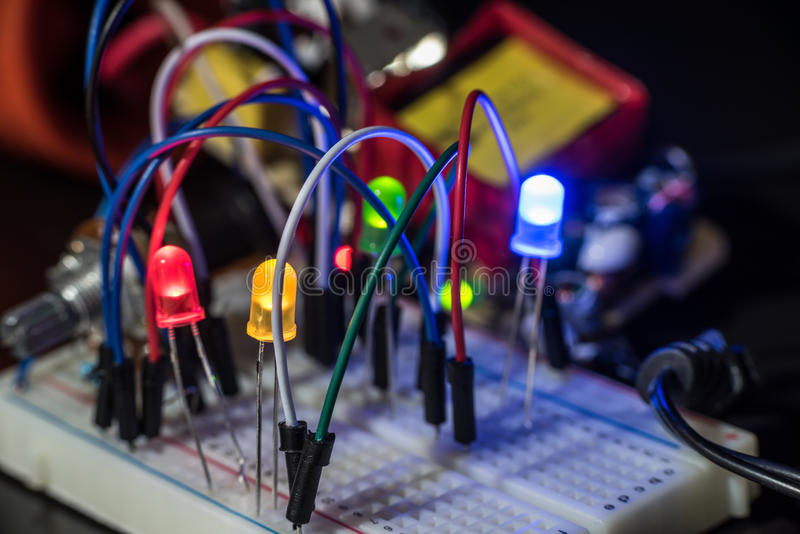Luminous LEDs and electronic components. Components of electronic devices and luminous LEDs royalty free stock photo