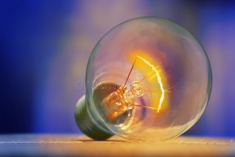 Luminous light bulbs against a background of blue shades, isolated on idea concept stock image