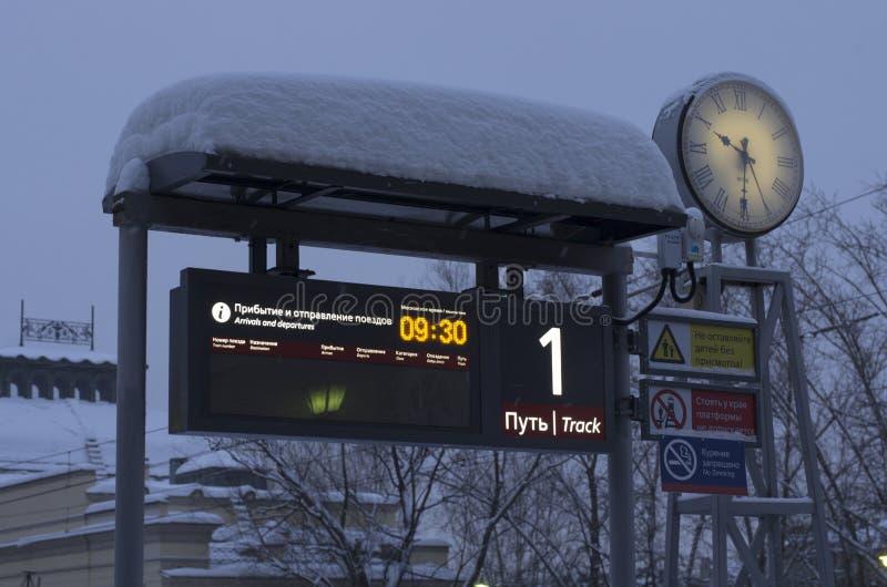 Luminous scoreboard platform number 1 and luminous clock stock photo