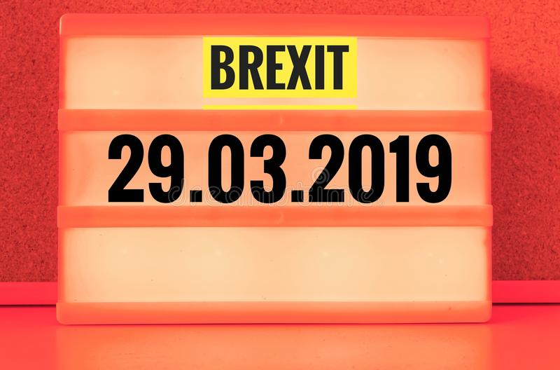 Luminous sign with inscription in english Brexit and 03/29/2019, in german 29.03.2019, symbolizing the withdrawal of Great Britain. From the EU stock images