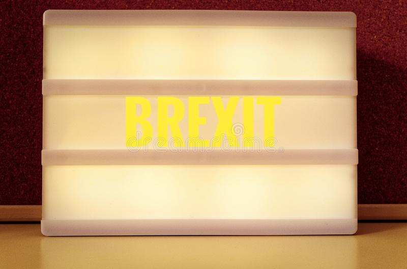 Luminous sign with inscription in German Brexit, symbolizing the withdrawal of Great Britain from the EU.  stock image