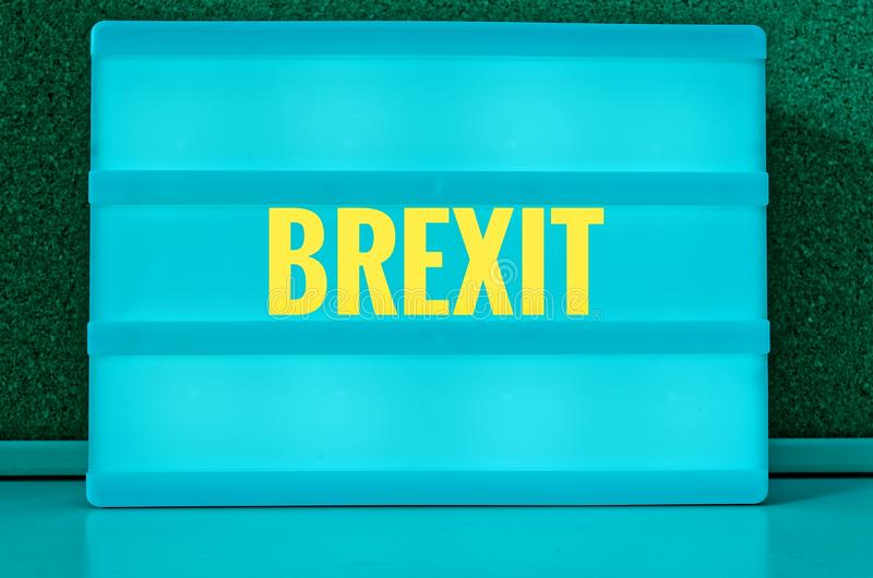 Luminous sign with inscription in German Brexit, symbolizing the withdrawal of Great Britain from the EU.  stock photo