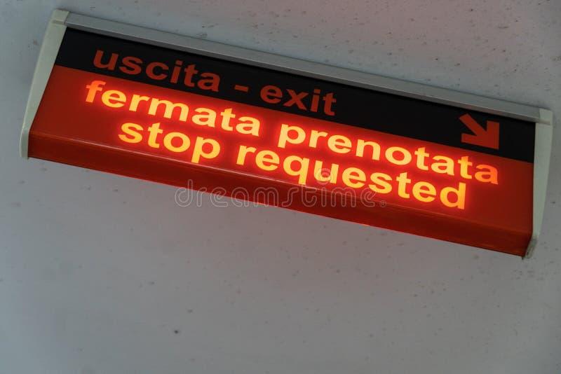 Stop sign in Italian. Luminous Stop requested sign Italian: fermata prenotata royalty free stock photo