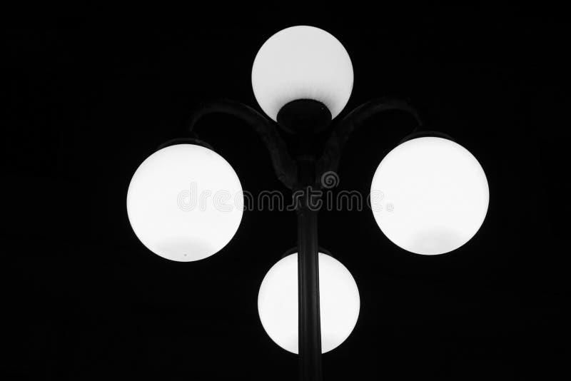 Luminous street lamp in the night stock photo
