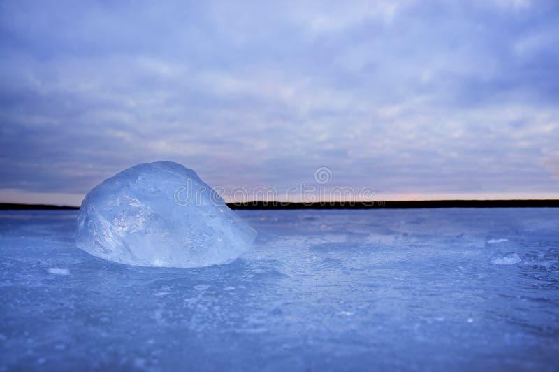 Lump of ice on frozen lake royalty free stock image
