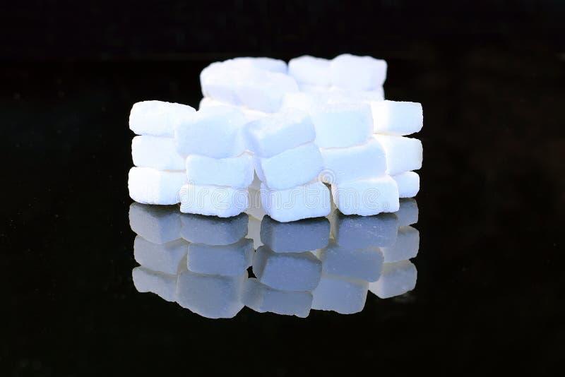 Lump sugar cubes stock photos