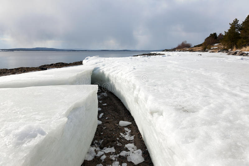 Lumps of ice on the shore of the northern sea royalty free stock photography