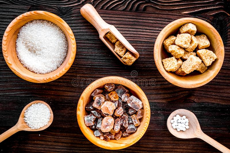Lumps and sanding sugar for sweets on wooden kitchen table background top view. Lumps and sanding sugar for cooking sweets on wooden kitchen table background top royalty free stock photos