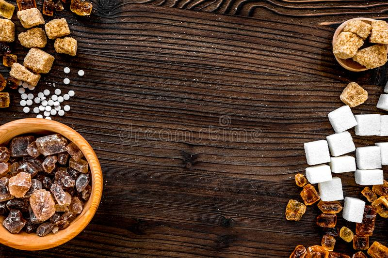 Lumps and sanding sugar for sweets on wooden kitchen table background top view mock up. Lumps and sanding sugar for cooking sweets on wooden kitchen table stock photography