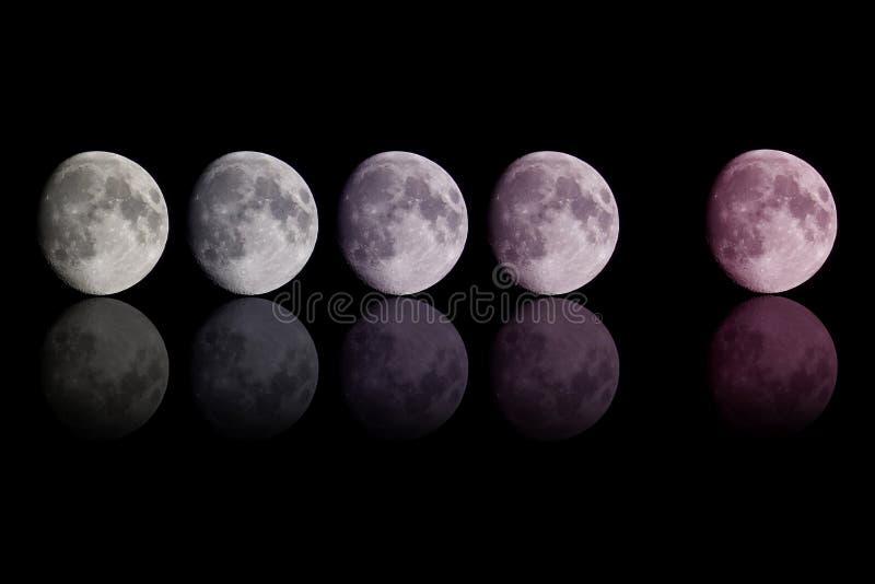 Luna del color de la pendiente en negro fotografía de archivo