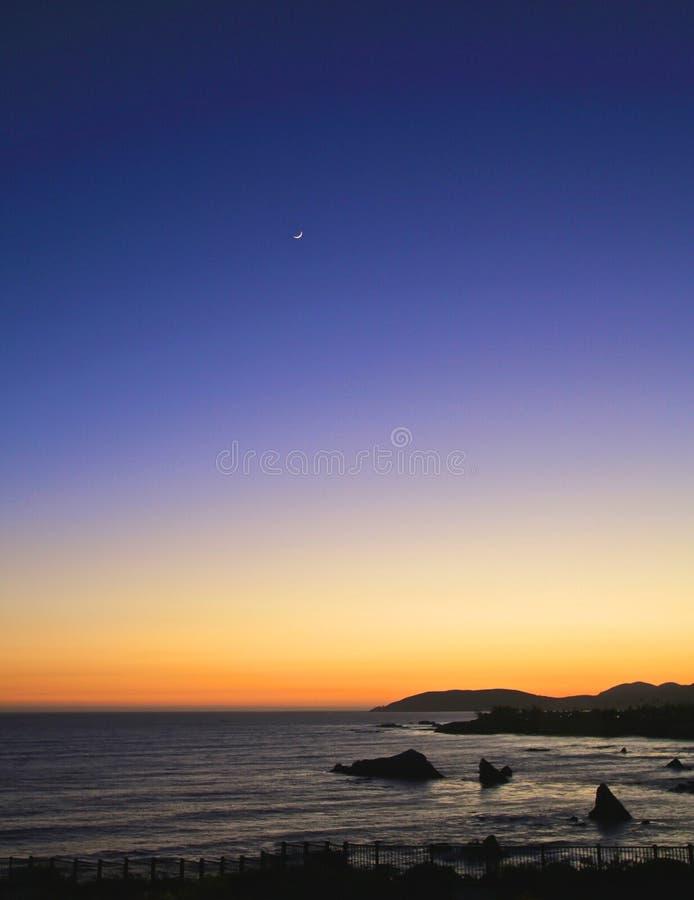 Luna della mezzaluna di tramonto immagini stock