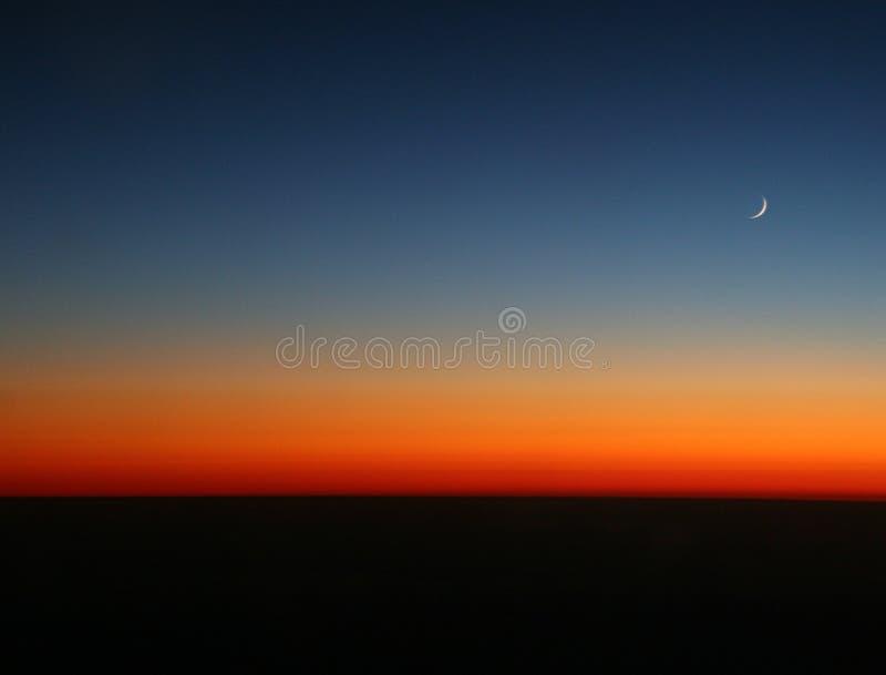 Luna di tramonto immagine stock