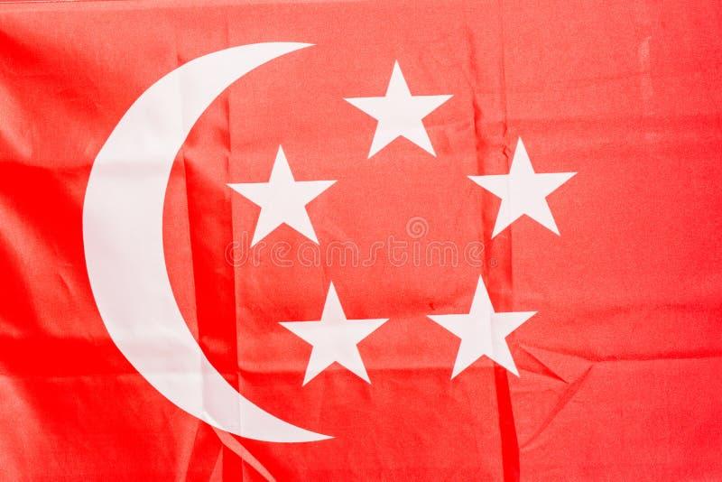 Luna e stella di vista del primo piano della bandiera di paese di Singapore per fondo immagine stock libera da diritti
