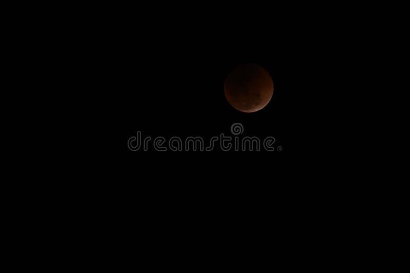 Luna estupenda de la sangre azul y eclipse lunar foto de archivo