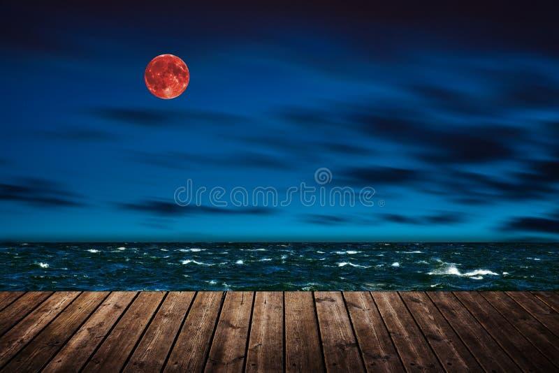 Luna rossa - bloodmoon fotografie stock