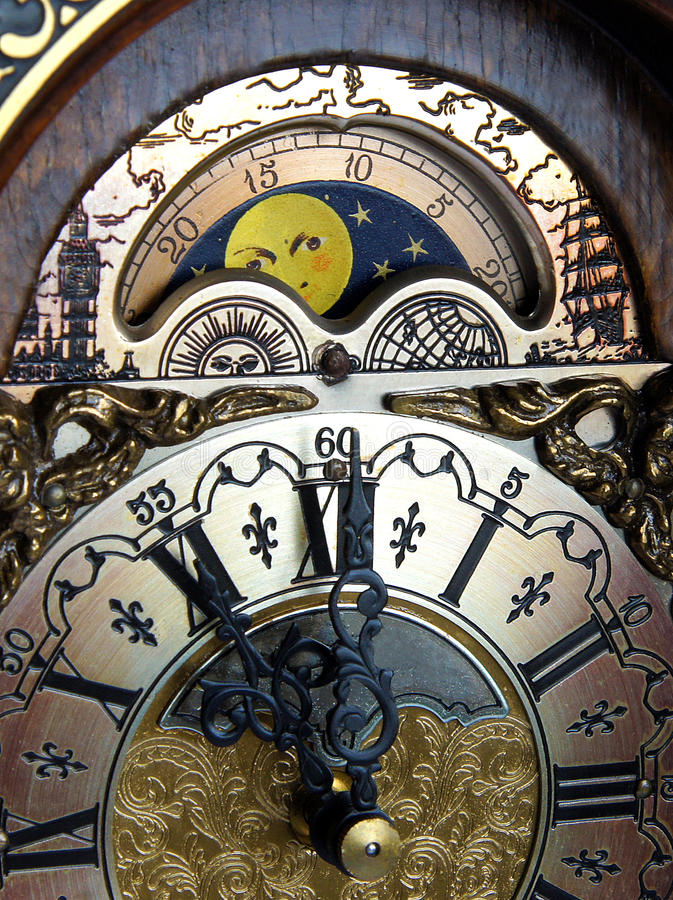 Lunar Calendar of mantel clock. Lunar Calendar with Moon phases above the dial of mantel clock royalty free stock photos