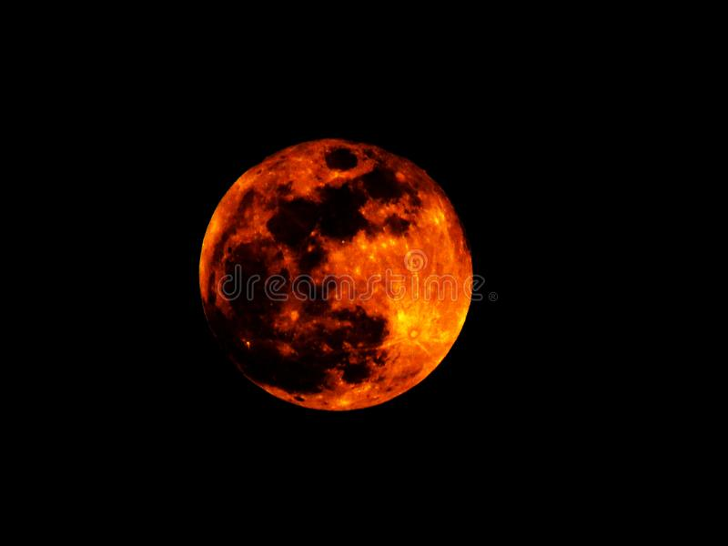 Lunar eclipse. Blood moon on black sky background. Super red full moon. Lunar Tetrad. Bright fire red moon against black sky. Dark, darkness, twilight. Global royalty free stock photos