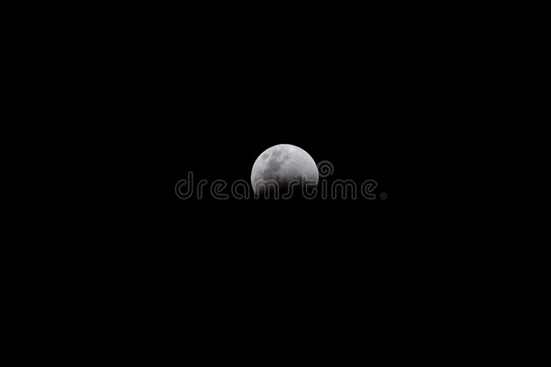 Lunar Eclipse Event on Black Background stock photography