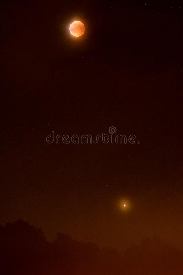 Lunar eclipse with Mars 2018 - Blood moon and the red planet downside stock photo