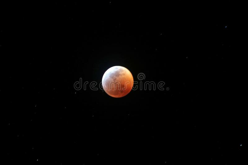 Lunar eclipse 2019 nearly full blood wolf moon stock photo
