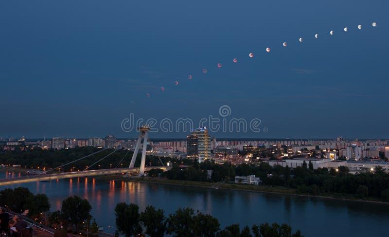 Lunar eclipse sequence in Bratislava, Slovakia stock photo