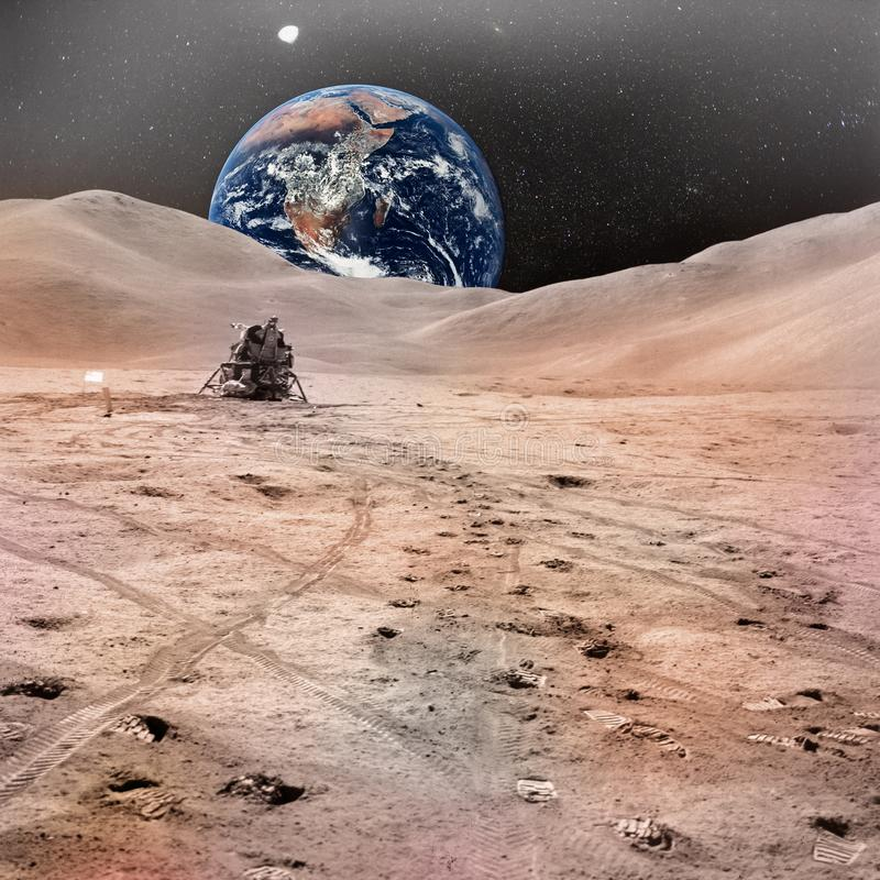 Lunar Module photographed against lunarscape. Lunar surface extravehicular, with human footprints and planet Earth in the sky. Elements of this image furnished royalty free stock photos