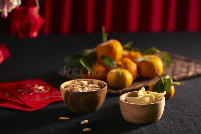 Lunar new year food and drink still life on black background. Translation of text appear in image: Prosperity.  royalty free stock image