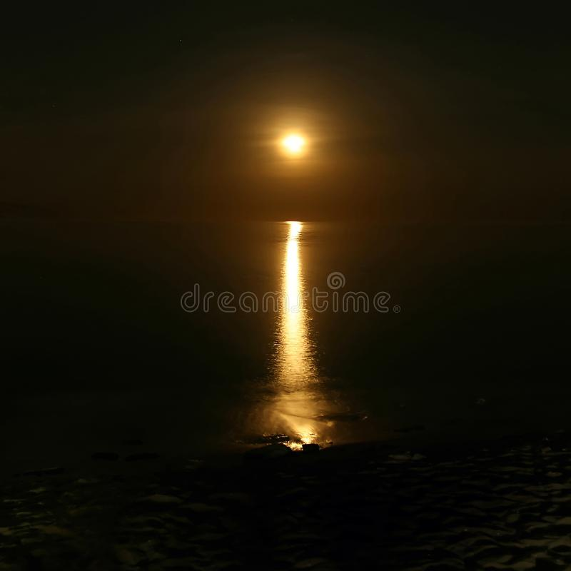 lunar path reflecting on the water stock images