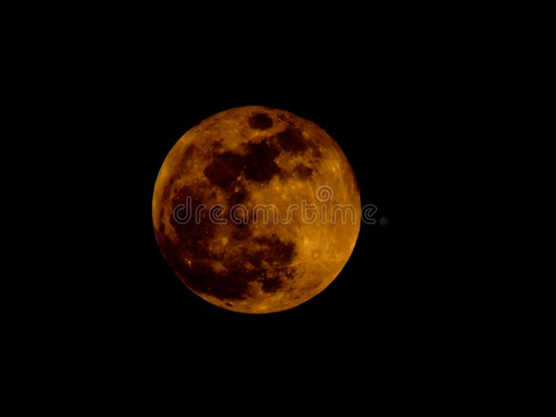Lunar Tetrad. Lunar eclipse. Blood moon on black sky background. Lunar eclipse. Blood moon on black sky background. Dark, darkness, twilight. Super red full royalty free stock photo
