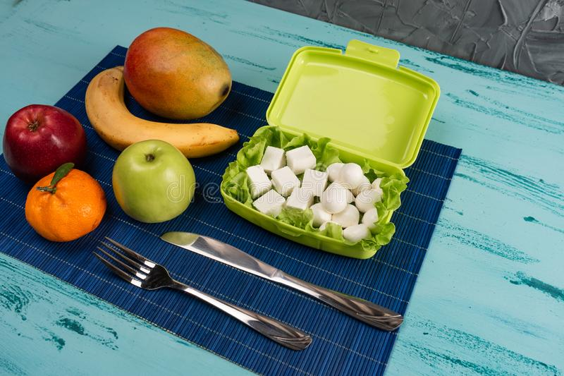 Lunch box with appetizing food and on light wooden table. Copy space. stock images