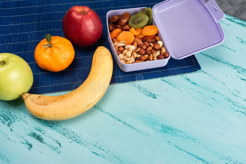 Lunch box with appetizing food and on light wooden table. Copy space royalty free stock photos