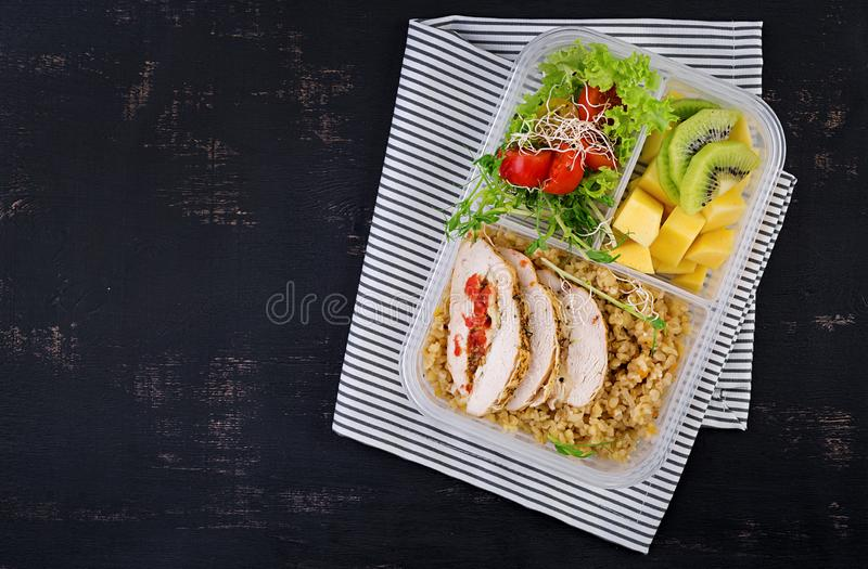 Lunch box  chicken, bulgur, microgreens, tomato  and fruit. Healthy fitness food. Take away. Lunchbox. Top view royalty free stock photo
