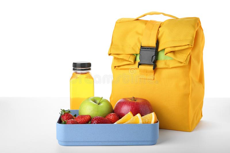 Lunch box with healthy food for schoolchild. On white background stock photography