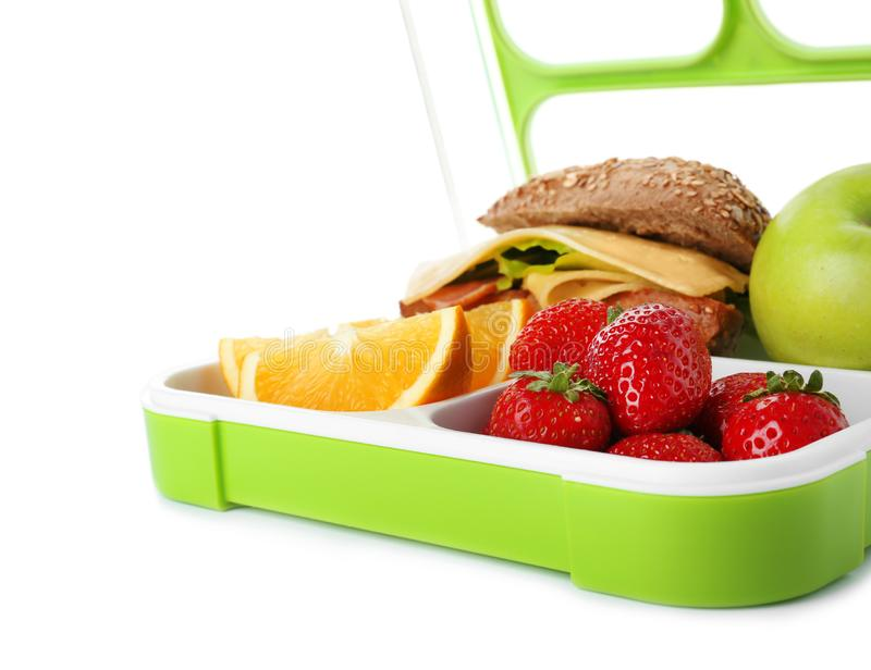 Lunch box with healthy food for schoolchild. On white background stock image