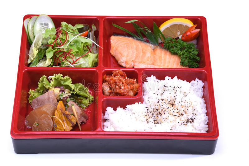 Lunch box of Roasted Salmon , Bento Salmon set isolated on white royalty free stock image