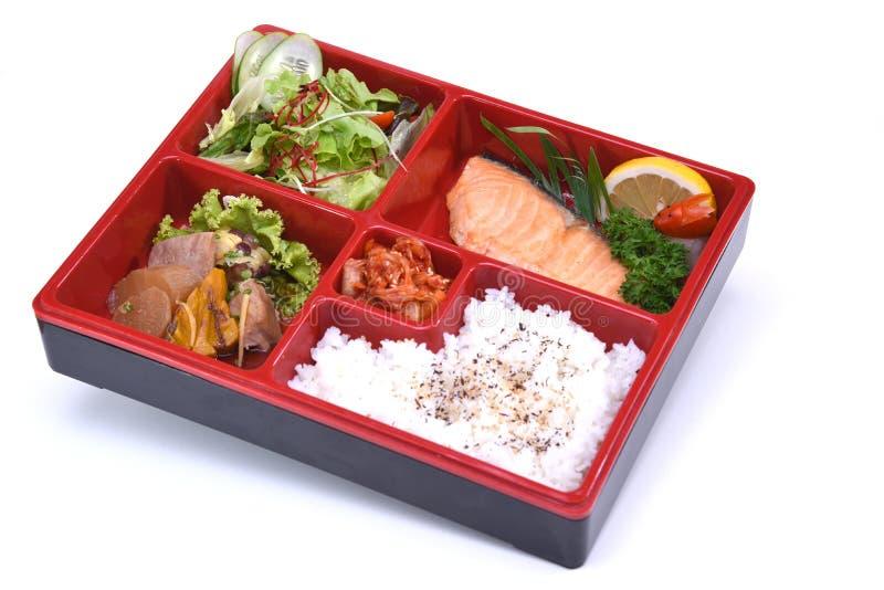 Lunch box of Roasted Salmon , Bento Salmon set isolated on white royalty free stock photo