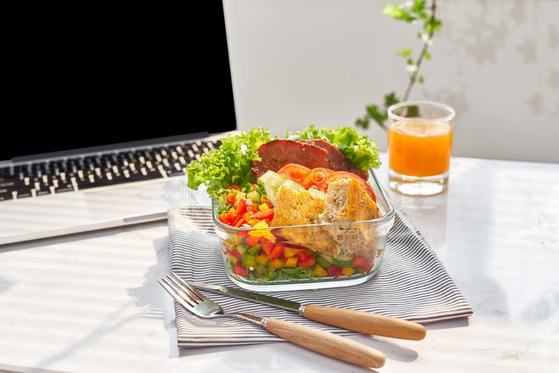 Lunch box on work place of working desk ,Healthy eating clean food habits for diet and health care concept.  royalty free stock photo