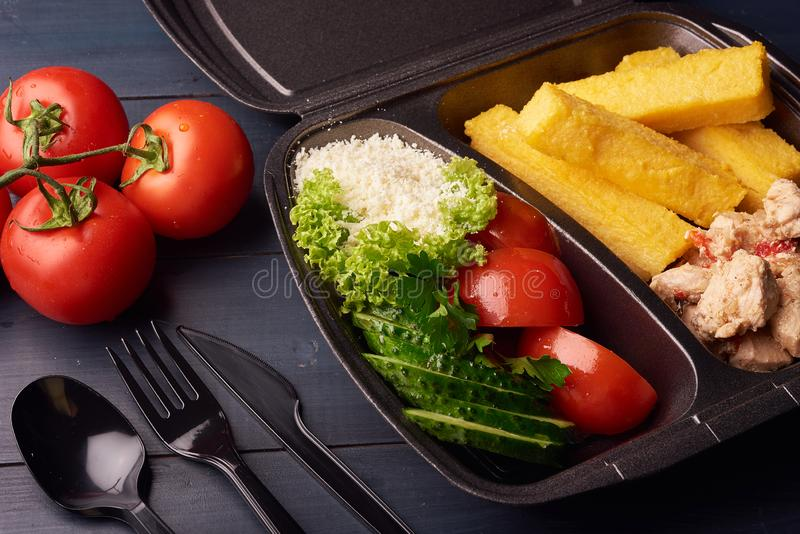 Lunch boxes with food ready to go for work or school, or dieting concept, vegetables and cheese. Close-up photo stock images